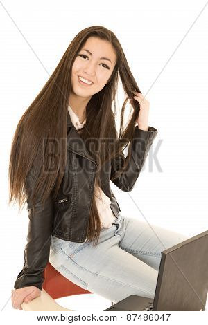 Cute Teen Girl Sitting On The Back Of Her School Desk Chair With Computer