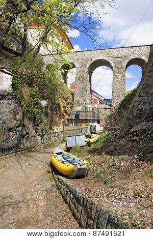 Yellow Air Rafts Under The Stone Bridge In City Of Cesky Krumlov
