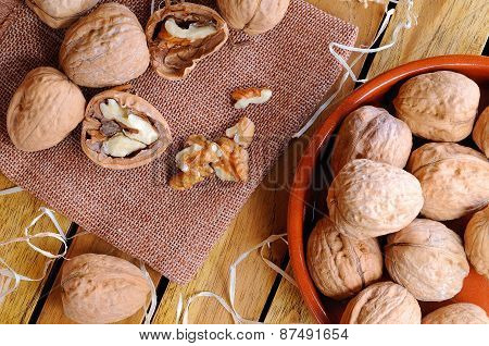 Group Of Healthy Walnuts On A Wooden Table Top View