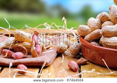 Group Of Peanuts On A Wooden Table In The Field