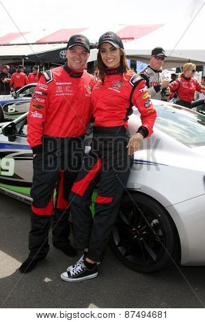 LOS ANGELES - FEB 7:  Brett Davern, Donna Feldman at the Toyota Grand Prix of Long Beach Pro/Celebrity Race Press Day at the Grand Prix Compound on FEB 7, 2015 in Long Beach, CA
