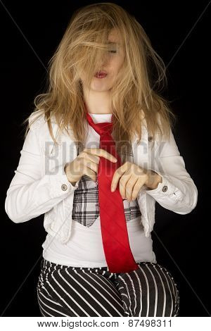 Young Female Model Straightneing Her Tie With Messy Hair