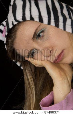 Close Up Portrait Of A Sad Woman Wearing Cat Pajamas