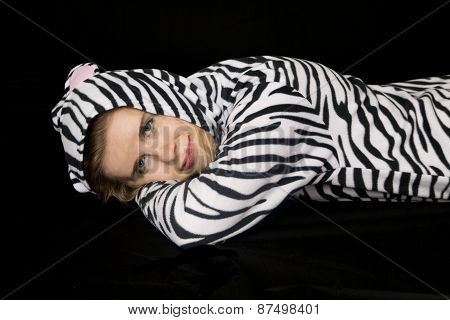Woman Wearing Cat Pajamas Laying Down And Smiling