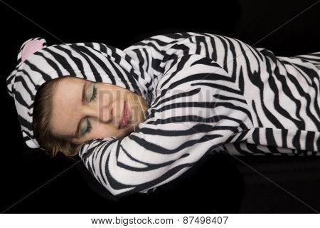 Woman Wearing Cat Pajamas Laying Down Asleep