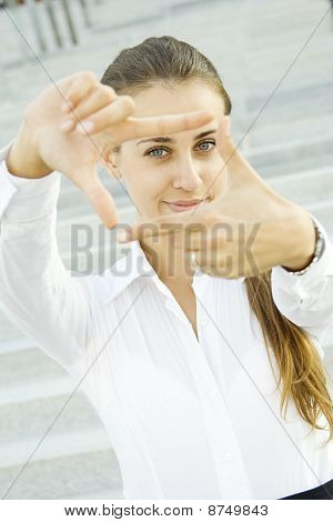 Looking through frame - sight businesswoman