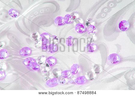 white and purple on white floral fabric