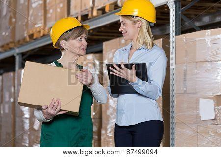 Engineer Talking With Storage Worker