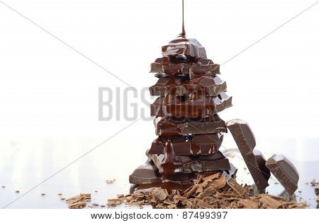 Stack Of Chocolate On Reflective Glass