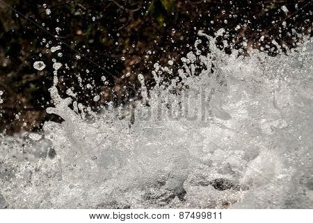 Water Drops Splashing Off A Waterfall
