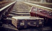 image of old suitcase  - Two old fashioned suitcases on the railway - JPG