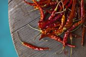 image of red hot chilli peppers  - Red hot chili peppers on an old wooden table texture. Spicy pepper. Food photography with cope space. Shallow depth of field, selective focus ** Note: Shallow depth of field - JPG