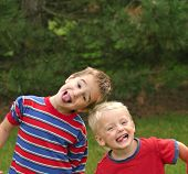 stock photo of young boy  - two young boys having fun making faces - JPG