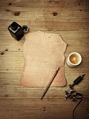 stock photo of wood pieces  - Piece of leather and tattoo machine on vintage wood desk - JPG
