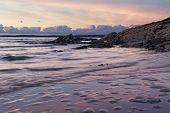 foto of nightfall  - Stunning nightfall over the sea shore in Wales - JPG