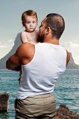 image of little girls photo-models  - Athletic father with adorable little daughter against sea background - JPG