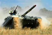 pic of battle  - Main battle tank  in the attack in the summer  field - JPG