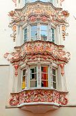 foto of building relief  - Ornate bow windows of medieval buildings in Old Town - JPG