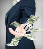 picture of throw up  - Close up of businessman throwing dice and dollars - JPG