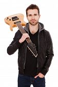 Handsome young man with an electric guitar. poster