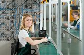 foto of manufacturing  - Young female production worker in manufacturing plant - JPG