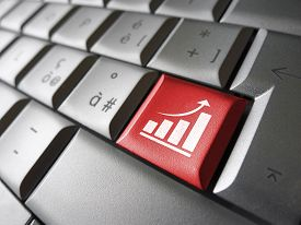 picture of arrow  - Positive business growth concept with growing bar graph and arrow icon and symbol on a red laptop computer key for Internet and online business - JPG