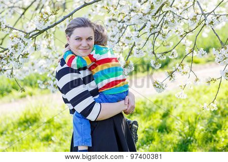Young Mum And Little Kid Boy In Blooming Garden
