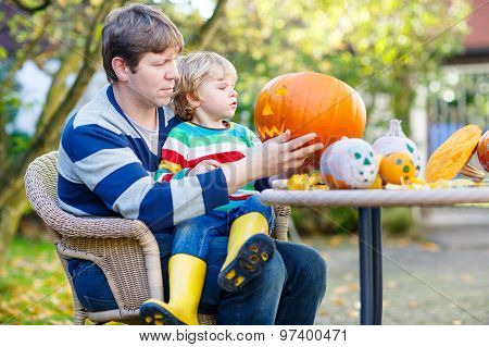 Little Child And His Father  Making Jack-o-lantern For Halloween