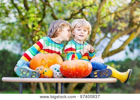 Two Little Sibling Boys Making Jack-o-lantern For Halloween In A