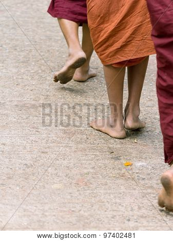 Foots Of Ascetic Buddhist Monk Walking At The Way To  Kyaikhtiyo.