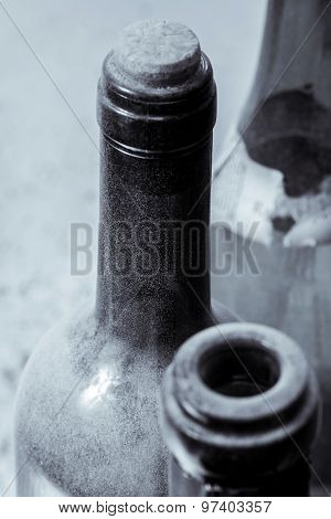 Some Very Old Wine Bottles - In  Black And White Shot.