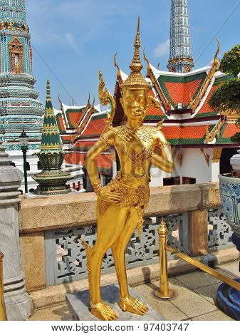 A Golden Kinnara statue at the Temple of the Emerald Buddha, Thailand.