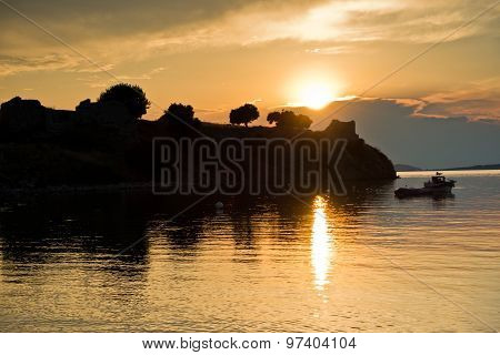 Sunset at Toroni bay near old roman fortress in Sithonia