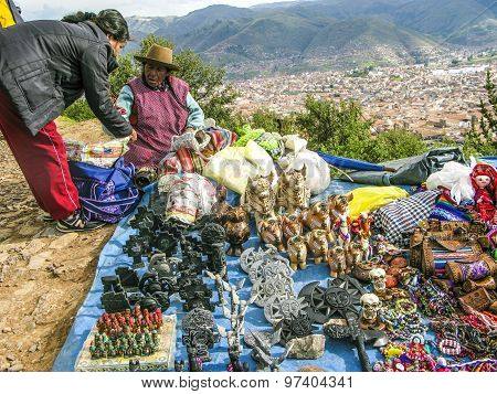 Indian Woman Sells Souvenirs To Tourists