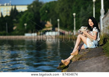 girl with a dog on the lake