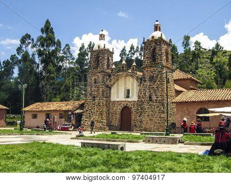 People Visit The Church San Pedro De Cacha In Raqchi