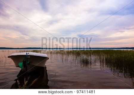 Evening Landscape At The Lake With The Boat