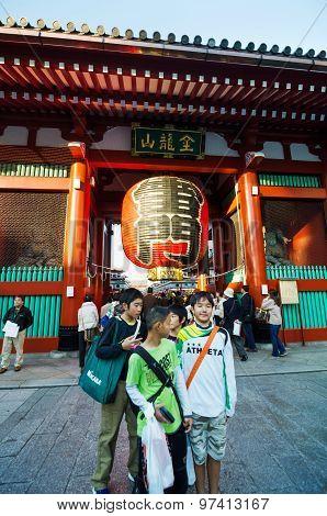 Tokyo, Japan - November 21, 2013: Tourists At The Entrance Of Sensoji Temple In Tokyo