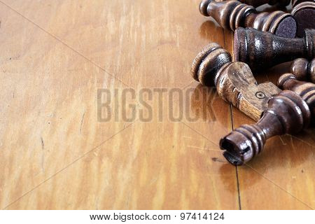 Wooden Chess Pieces On Table Made Of Wood. Empty Copy Space Background Presentation.