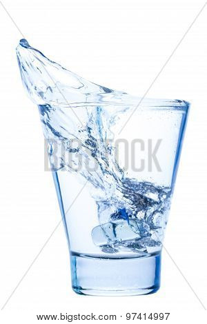 Splash Of Water In An Elegant Glass With Ice Isolated On White Background