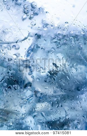 Water Drops On Glass With Ice. Macro