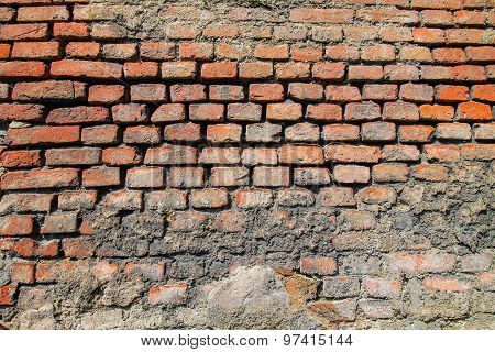 Brick Wall With Concrete Orange Texture.