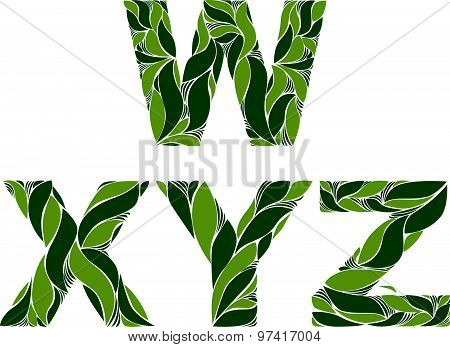 Beautiful typescript with natural spring pattern created from green leaves. Flowery alphabet