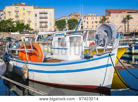 Small White Wooden Fishing Boat In Port