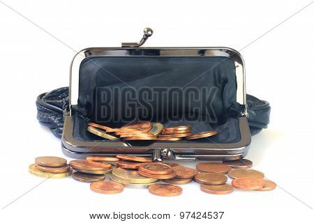 Money Coins Inside Black Leather Purse, White Background.