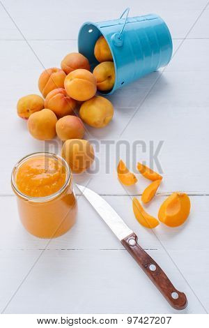 Slices Of Fresh Apricot, Knife, Apricot Puree In A Glass Jar.
