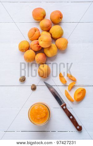 Slices Of Apricots, Fresh Apricots And Apricot Puree In Glass Jar