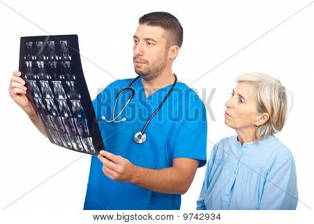 Serious Doctor Man Showing Mri To Patient