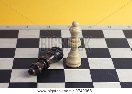 Chess Queen Wooden Figurines Fighting Photo With Wooden Chess Pieces.