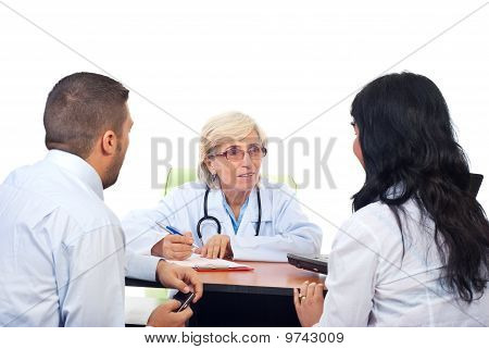 Senior Doctor Offers Medical Advices To A Couple